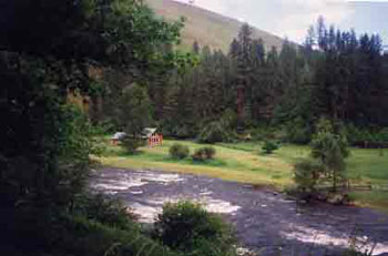 Log cabin rental in Idaho has private river front for great fly fishing.